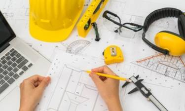 Hand over construction plans with yellow helmet and drawing tool 1232 2909
